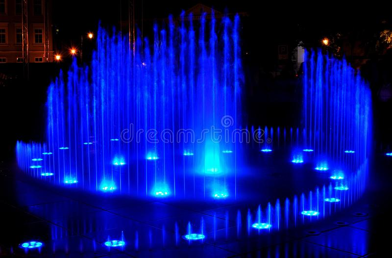 Fountain water. The fountain, which at night becomes a beautiful play of light and water royalty free stock images