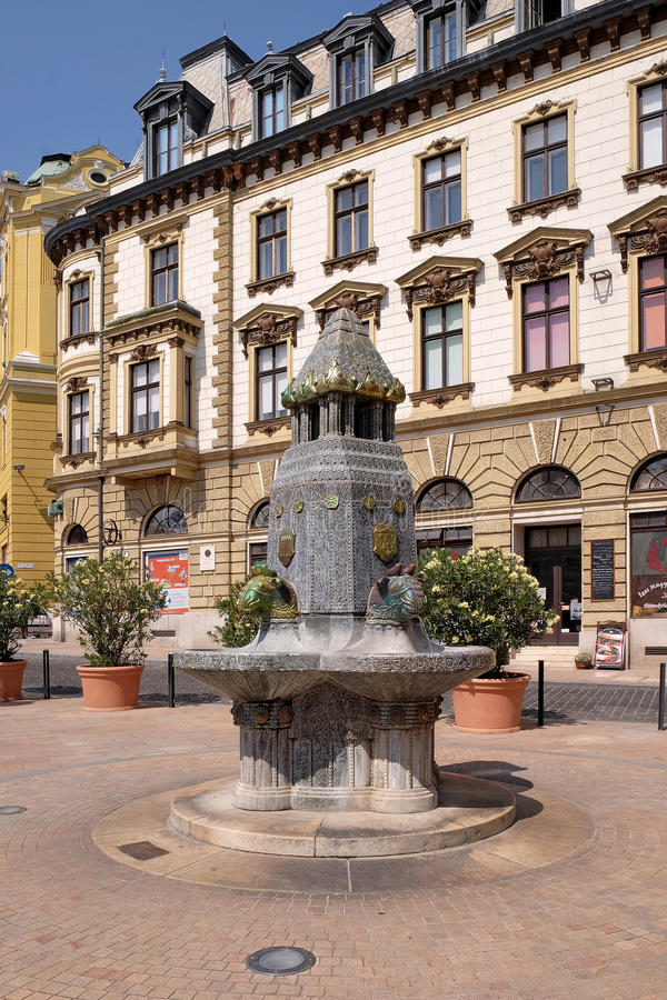 Fountain with Zsolnay manufactured sculptures in the main square in Pecs Hungary royalty free stock photos
