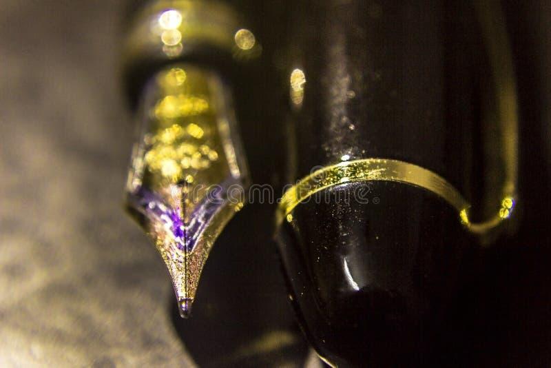 Fountainpen and nib. Closeup of a fountainpen and nib royalty free stock photos