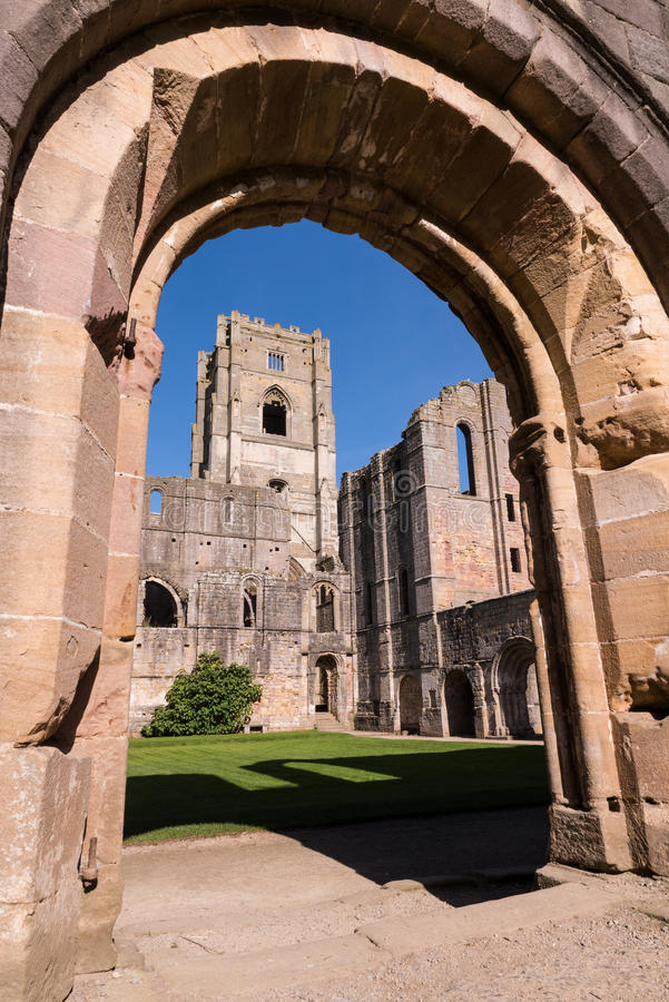 Fountains Abbey Ruins in England. Fountains Abbey is one of the largest and best preserved ruined Cistercian monasteries in England. Founded in 1132, the abbey royalty free stock photography