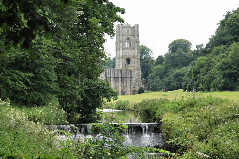 Fountains Abbey and Weir. Fountains Abbey near to Ripon in North Yorkshire, England. The remains of a Cistercian monastery, and the largest Abbey ruins in royalty free stock photos