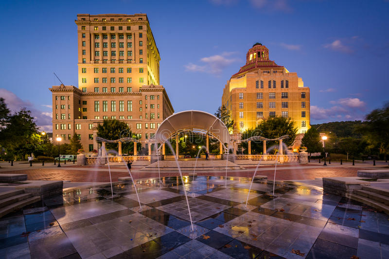 Fountains and buildings at night, at Pack Square Park, in downtown Asheville, North Carolina. royalty free stock photo