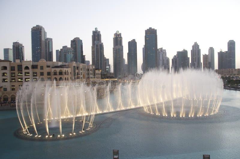 Fountains at Dubai Mall. Water Fountain Show at sunset - outside the Dubai Mall, Burj Khalifa Lake royalty free stock image