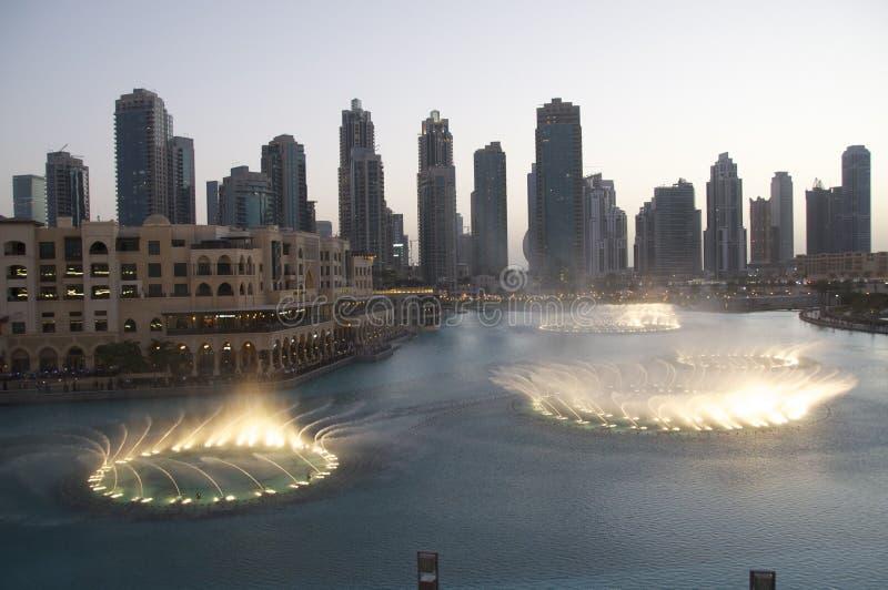 Fountains at Dubai Mall. Water Fountain Show at sunset - outside the Dubai Mall, Burj Khalifa Lake royalty free stock photography