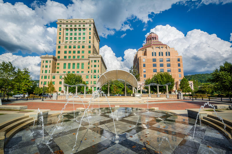 Fountains at Park Square Park and buildings in downtown Asheville, North Carolina. stock photo