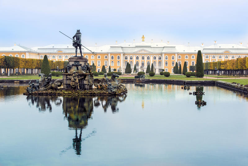Statue of Neptun in Fountains of Peterhof Palace, St. Petersburg, Russia. Beautiful delicate pastel winter colours  royalty free stock image
