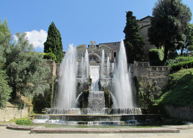 Fountains Villa d'Este garden. Villa d'Este fountains and antique marble statues of gods, woman, mythological creatures and heraldic eagles. Beautiful green stock images