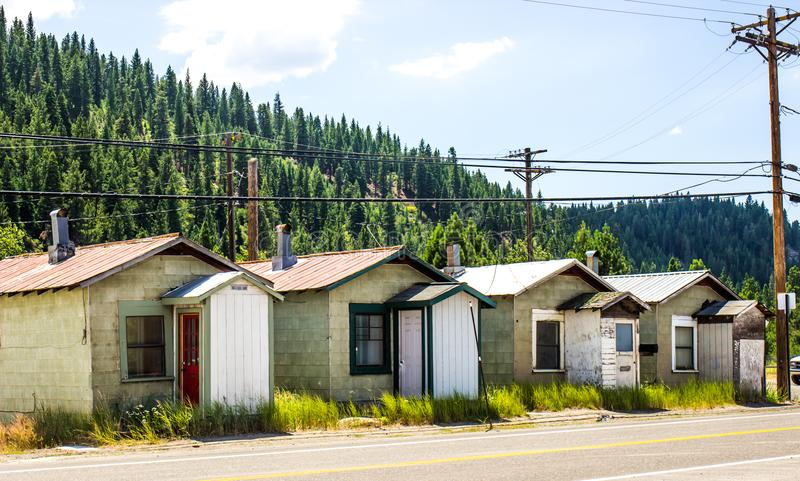 Four Abandoned Mini Bungalows In Mountains royalty free stock image