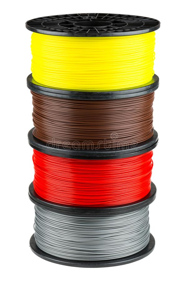 Four ABS or PLA filament coils royalty free stock photography