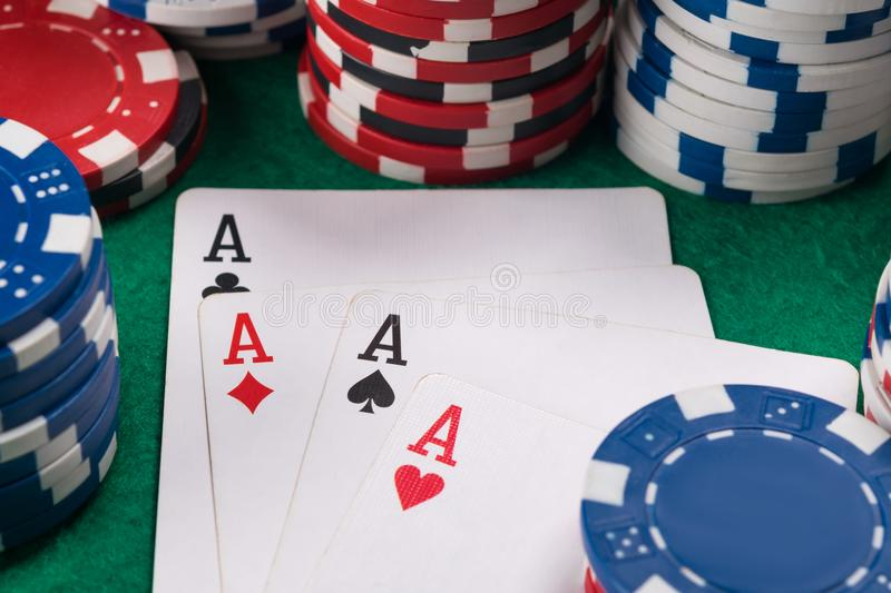 Four aces in cards for poker luck for a poker player on a casino table royalty free stock photo