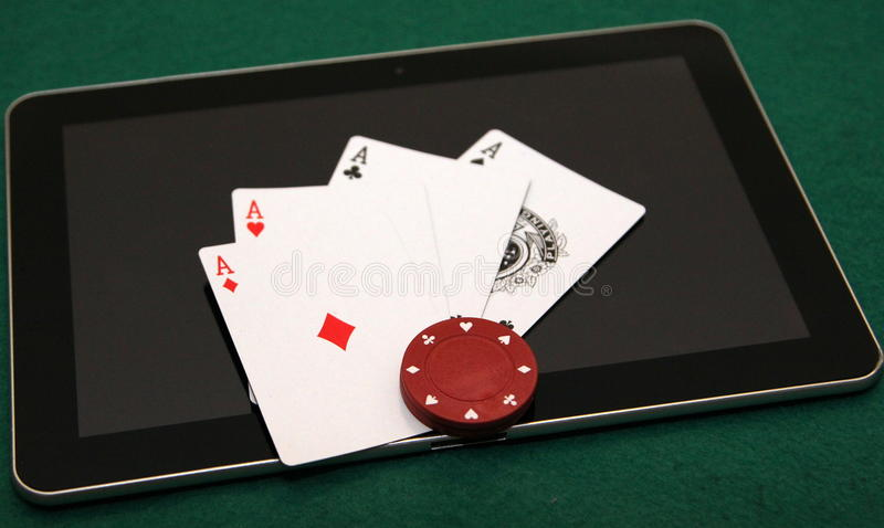 Four aces on tablet royalty free stock image
