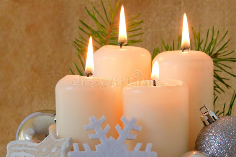 Four advent candles. Four advent candles and christmas decoration royalty free stock photography