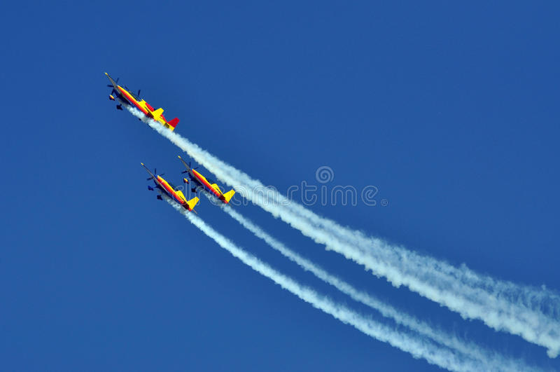 Four aerobatic airplanes flying during an air show stock photography