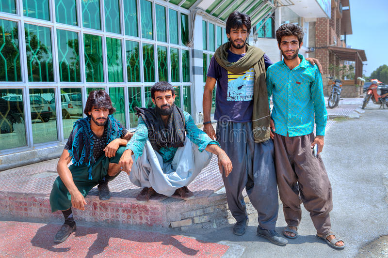 Four Afghans outside the Iranian city. Bandar Abbas, Hormozgan Province, Iran - 16 april, 2017: A group of young Afghan men in an Iranian city royalty free stock photo