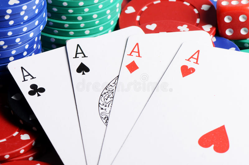 Four ases and casino chips stock photography