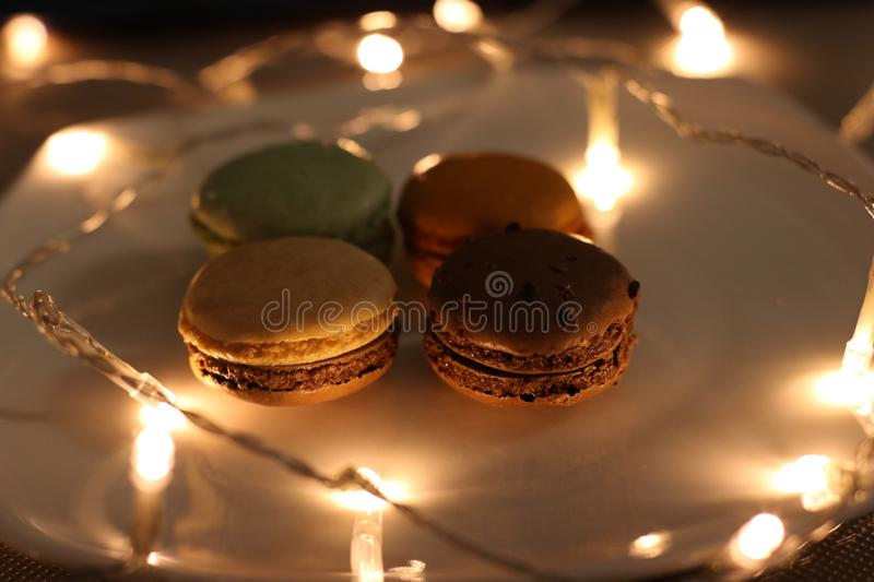 Four Assorted Macaroons on Plate royalty free stock image