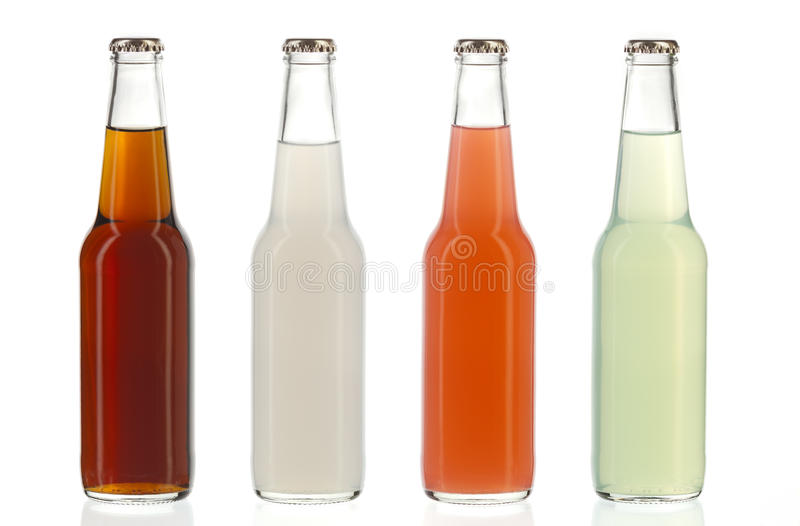 Four assorted soda bottles, alcoholic drinks royalty free stock photo