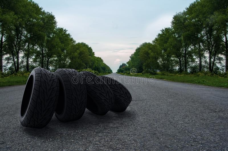 Four tires on the road. Four auto tires on the road royalty free stock images