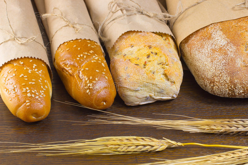 Four baguette and sticks of barley on table. Four baguette and sticks of barley on the table stock photography