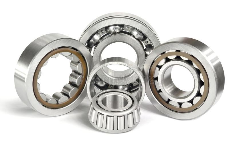 Four ball bearings. Four roller and ball bearings on a white background royalty free stock photos