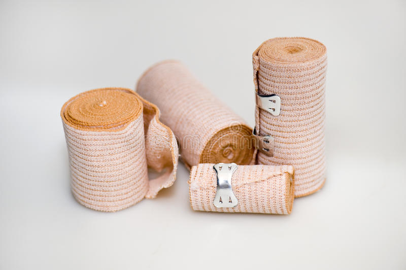 Four bandages. Close up of four different sized bandages stock image