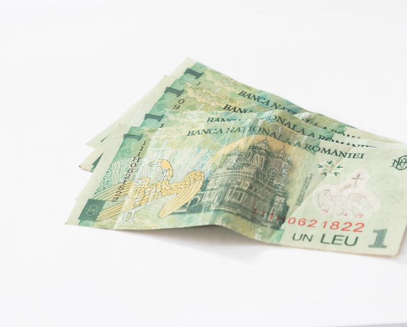 Four banknotes worth 1 Romanian Leu isolated on a white background stock photo
