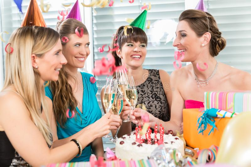 Four beautiful and cheerful women toasting with champagne stock photography