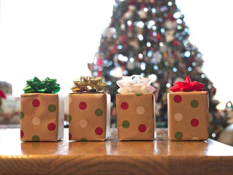 Four beautifully wrapped gift boxes on wood table stock photography