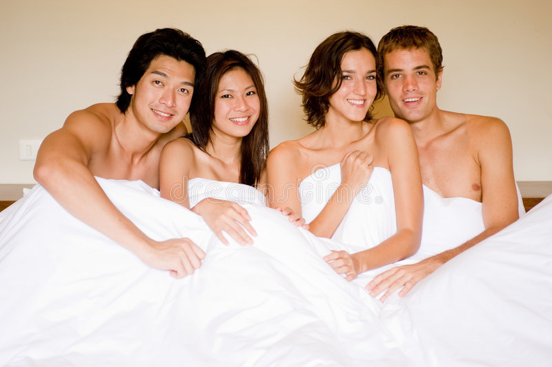 Download Four In A Bed stock image. Image of asian, bedroom, duvet - 4511213