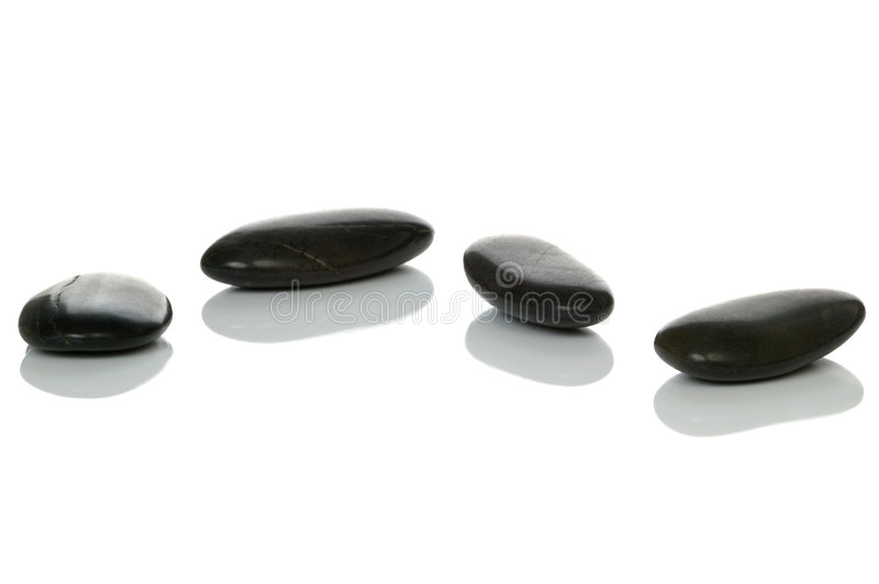 Four black pebbles
