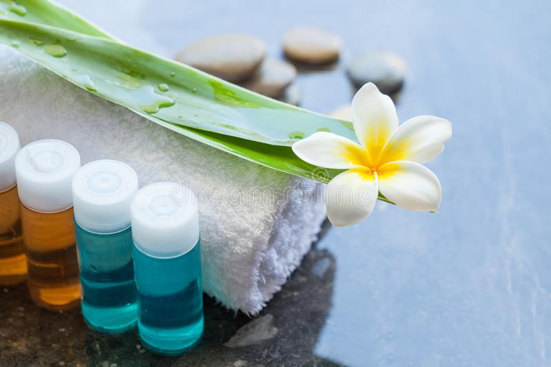 Four bottles Spa or wellness oil with tropical flower royalty free stock photography