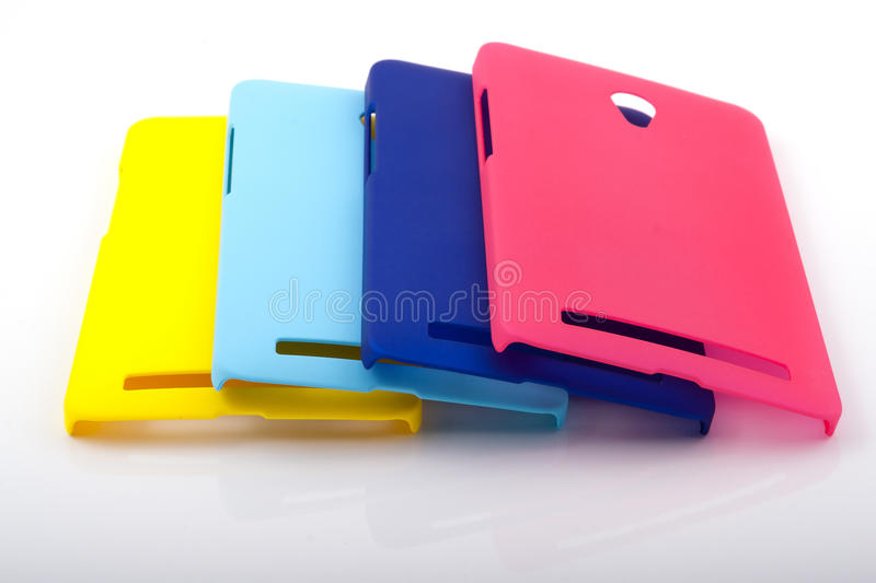 Four bright smartphone back covers stock photos