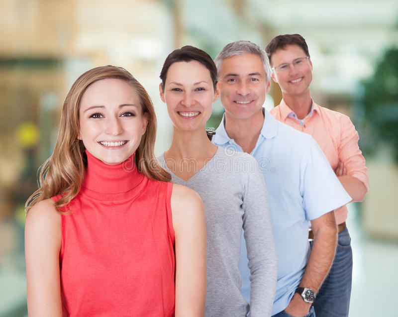 Four business associates in casual clothes stock image