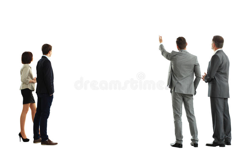 Four business mans from the back. Looking at something over a white background royalty free stock photos