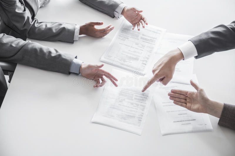 Download Four Business People Arguing And Gesturing Around A Table During A Business Meeting, Hands Only Stock Photo - Image: 33402976