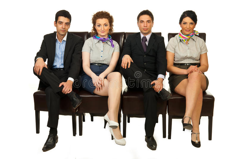 Four business people on chairs royalty free stock images