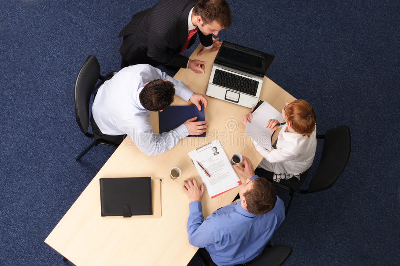 Four Business People Meeting Stock Photo