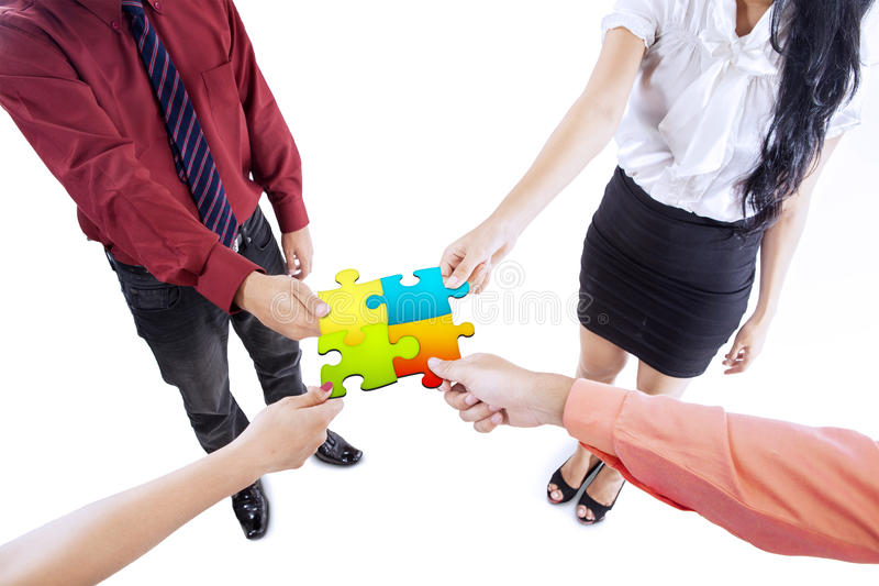 Business team building puzzle stock photos