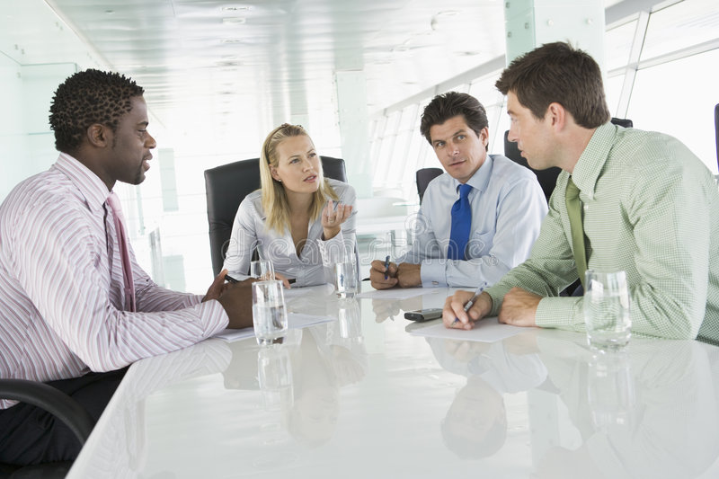 Four Businesspeople Having Meeting royalty free stock photo