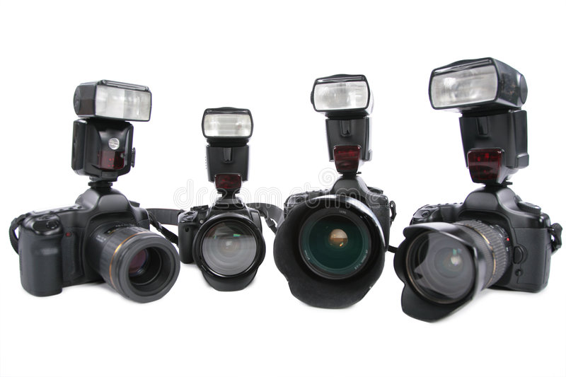 Four Cameras with flashes on white background. Four Cameras with flashes on a white background royalty free stock image