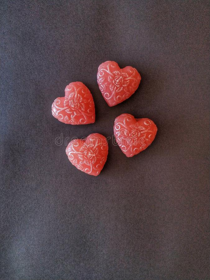 Four candles hearts stock photography