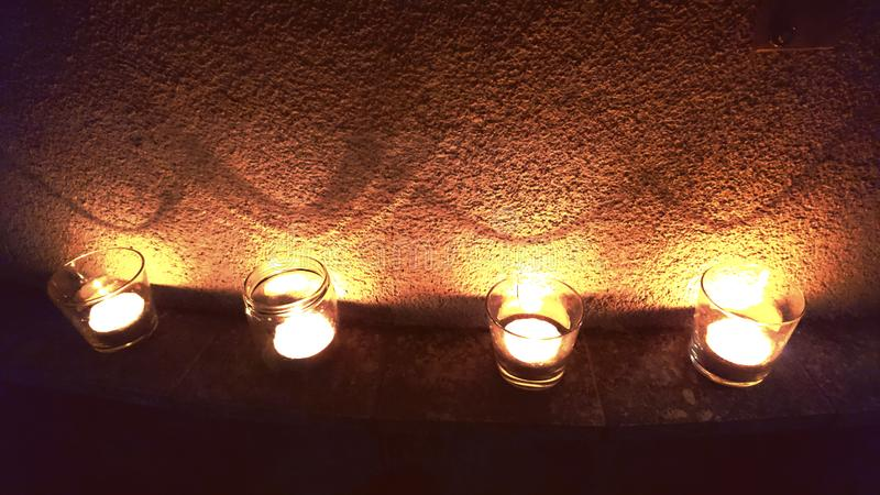 Four Candles Lightning Up The Wall stock photos