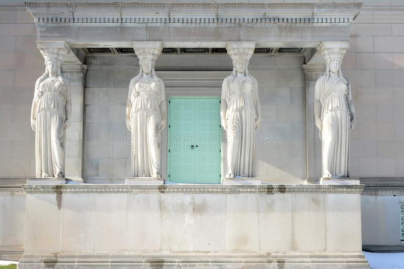 Four Caryatids in Chicago. This is a Winter picture of a set of four caryatids on the West end of the Museum of Science and Industry located in Chicago, Illinois stock photos