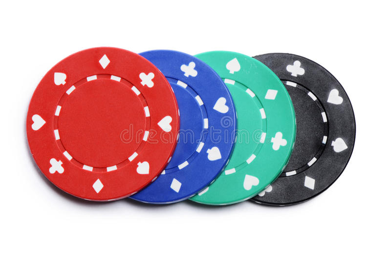 Four casino chips on white royalty free stock image