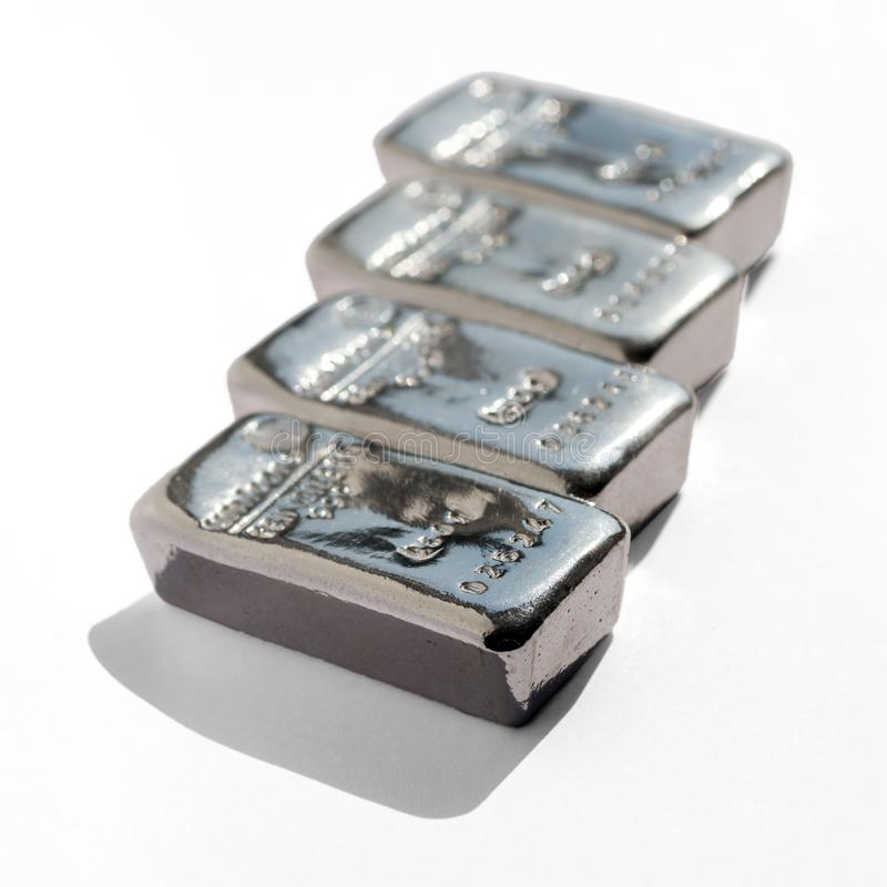 Four cast silver bars isolated on white background. stock photo
