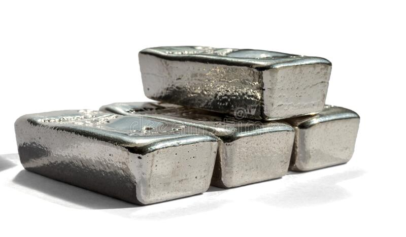 Four cast silver bars isolated on white background. Selective focus stock photo