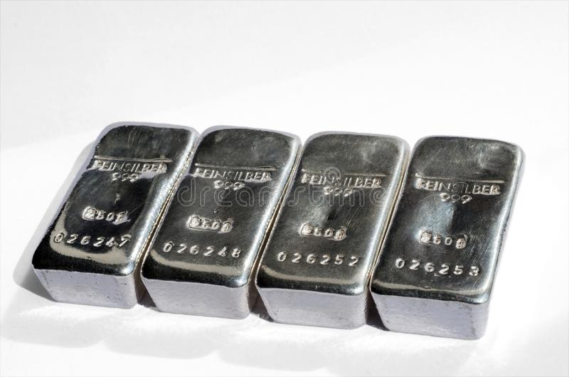 Four cast silver bars isolated on white royalty free stock images
