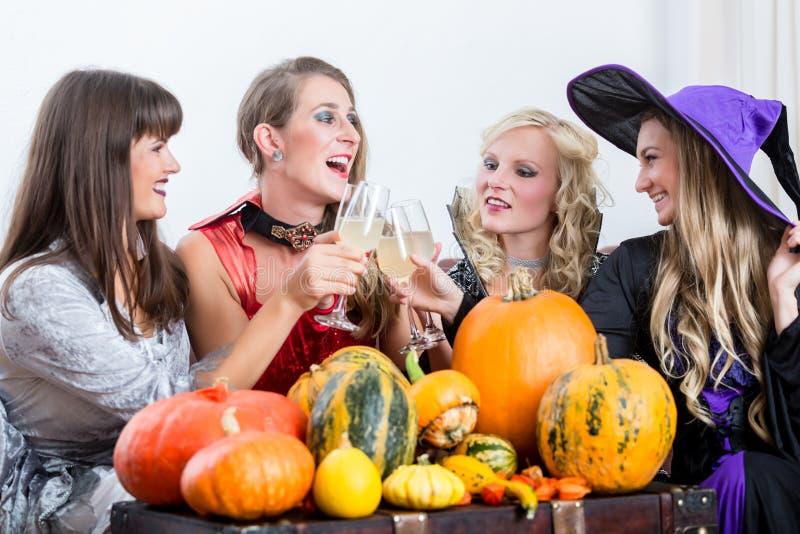 Four cheerful women celebrating Halloween together stock photos