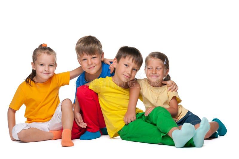 Four cheerful kids stock photo
