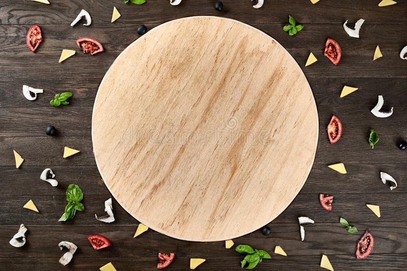 Four cheese pizza quattro fromaggi on a rustic wooden board on the table with ingridients. Selective fovus stock images